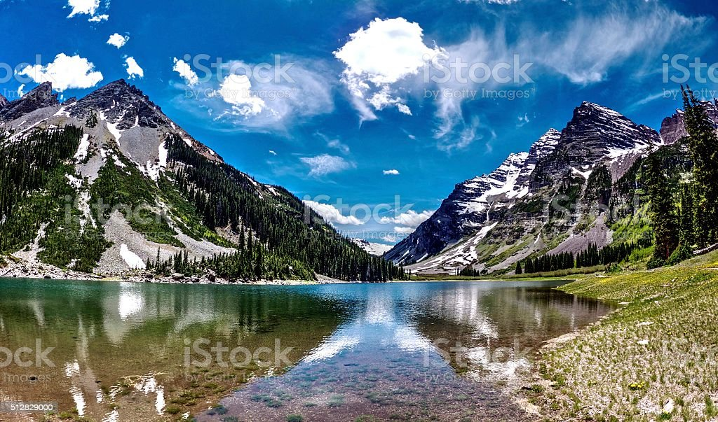 Reflection of Mountains and Clouds in the Lake stock photo