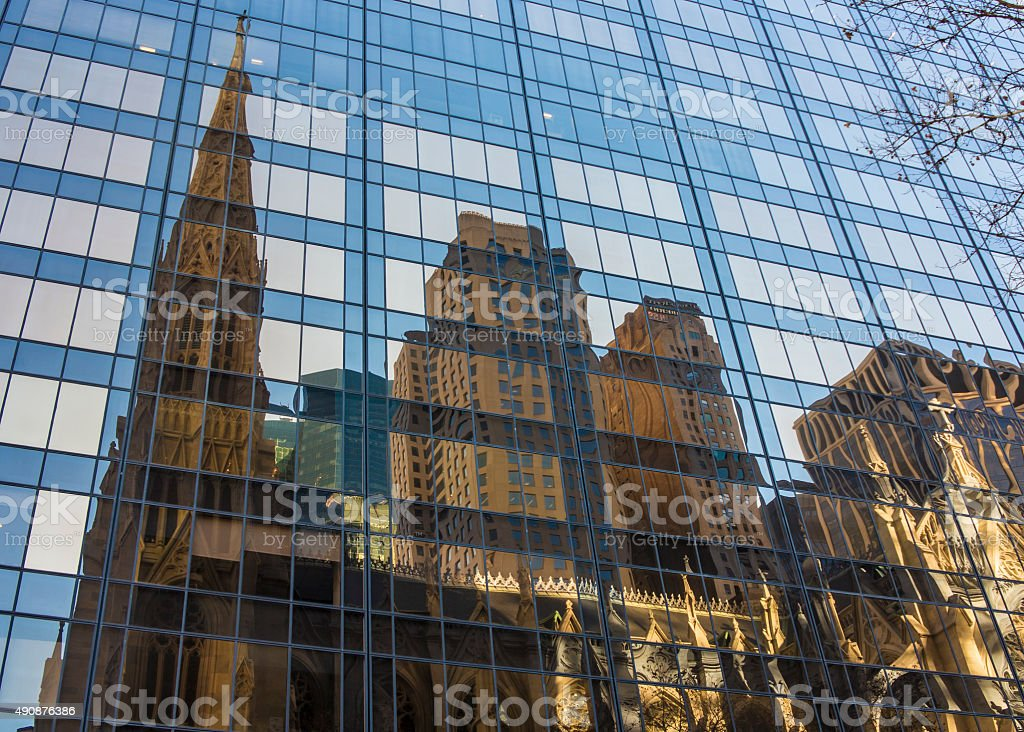 Reflection of old church in the modern glass building stock photo