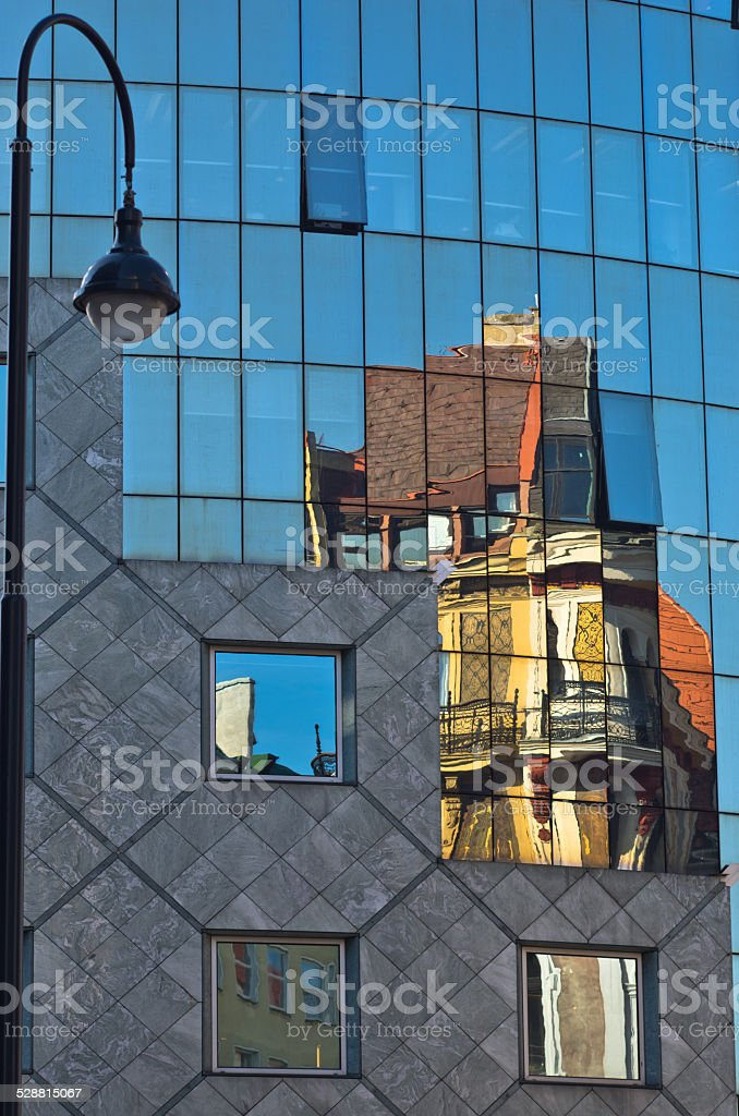 Reflection of old style buildings in glass of Haas House stock photo
