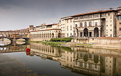 Reflection of Ponte Vecchio and Uffizi Gallery in River Arno