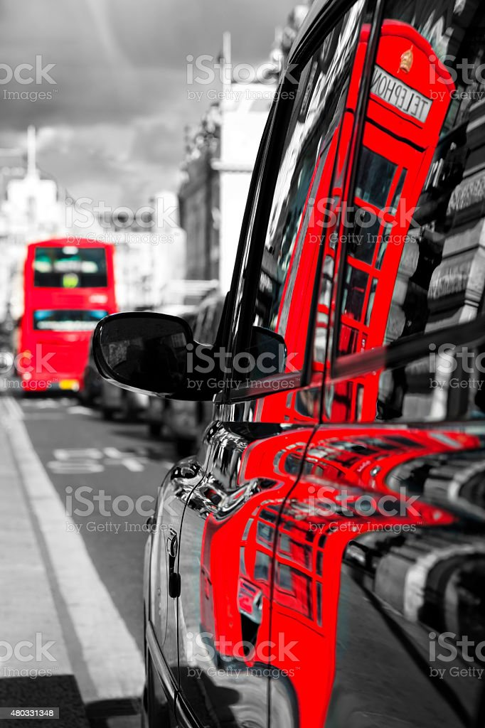 Reflection Of Red Telephone Booth in Taxi Cab, London, England stock photo