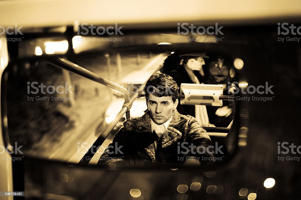 Reflection of Retro-Styled Man in Mirror. Sepia Toned stock photo