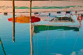 Reflection of sail boat