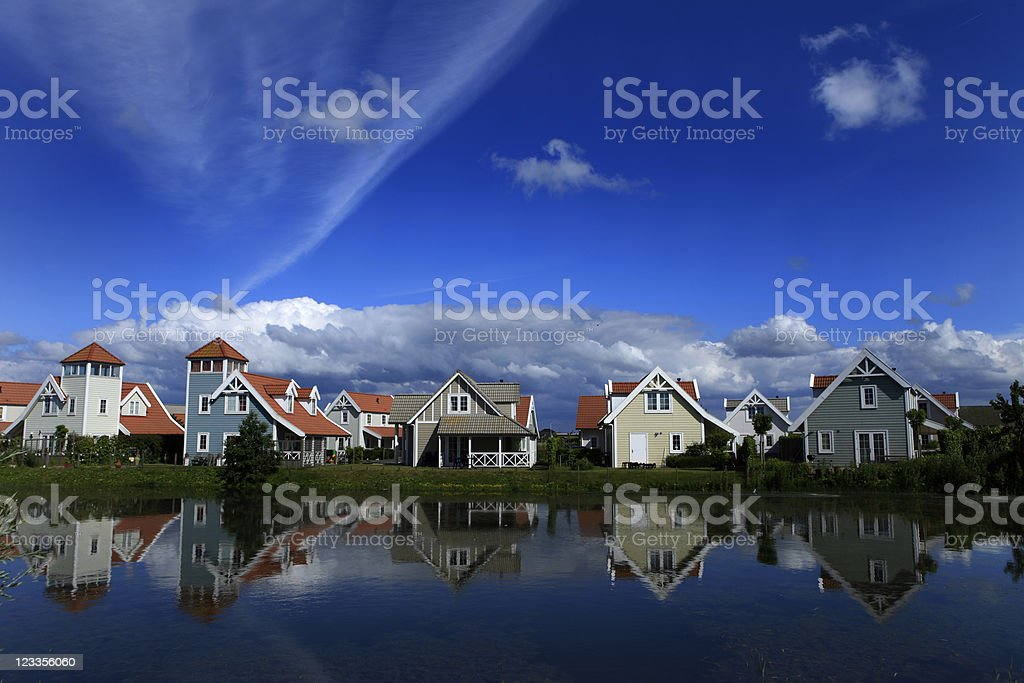 reflection of Scandinavian style holiday houses in the water royalty-free stock photo