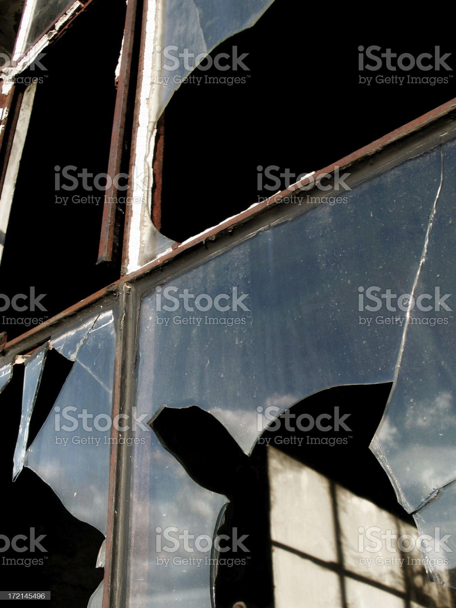 Reflection of sky in broken window royalty-free stock photo