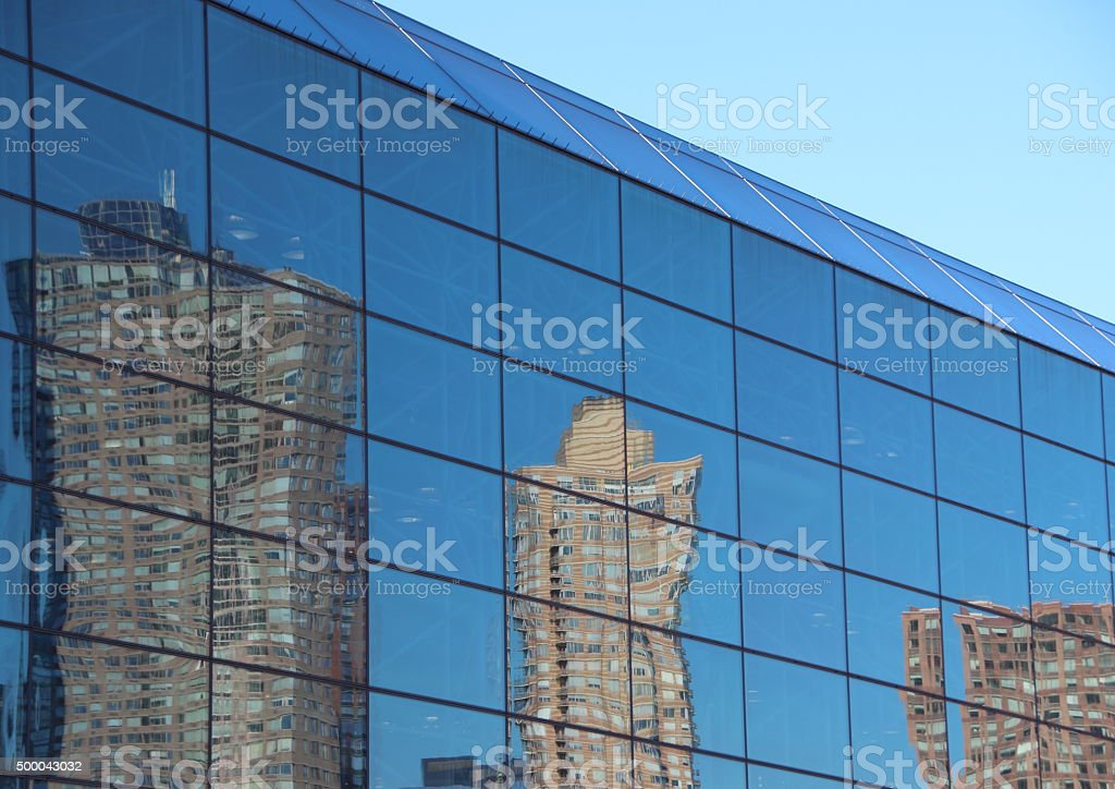 Reflection of Skyscraper in Blue Window Facade stock photo
