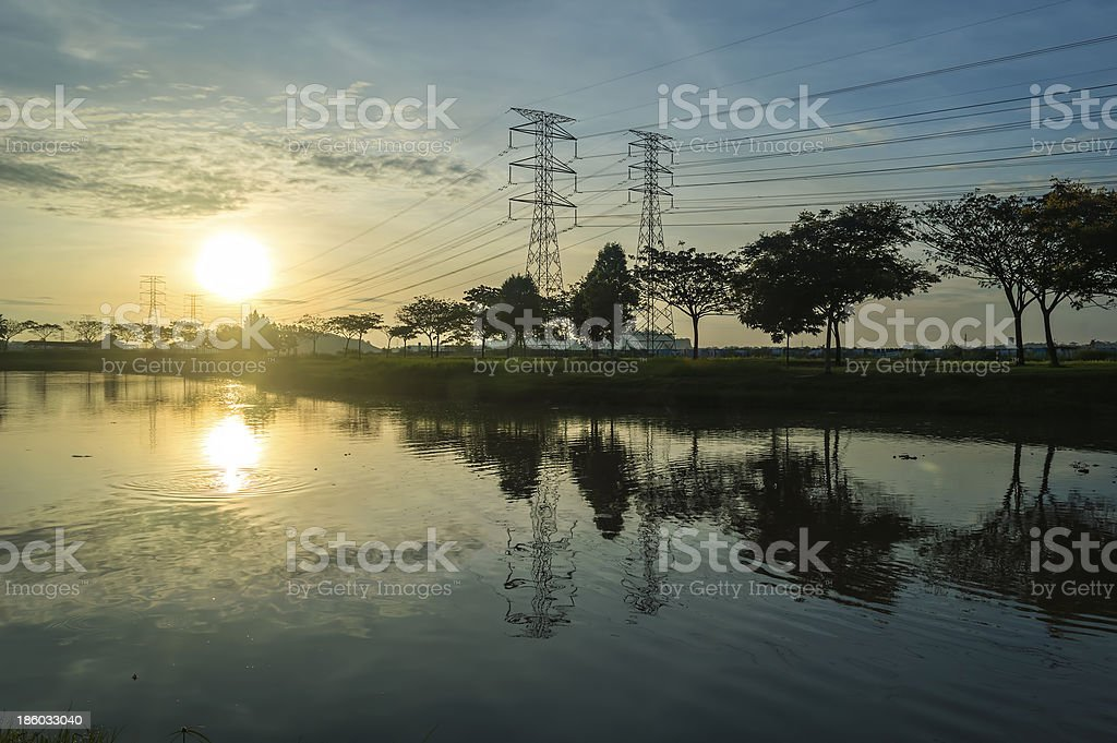 Reflection of sunrise and electrical tower royalty-free stock photo
