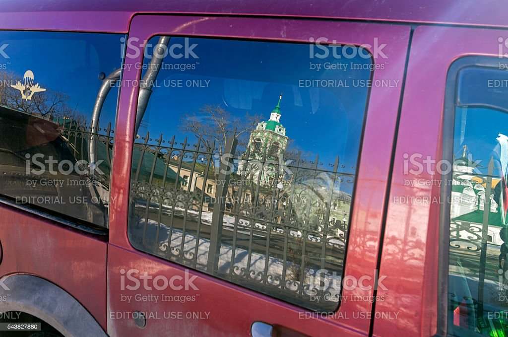 Reflection of the  belfry  in car window. stock photo