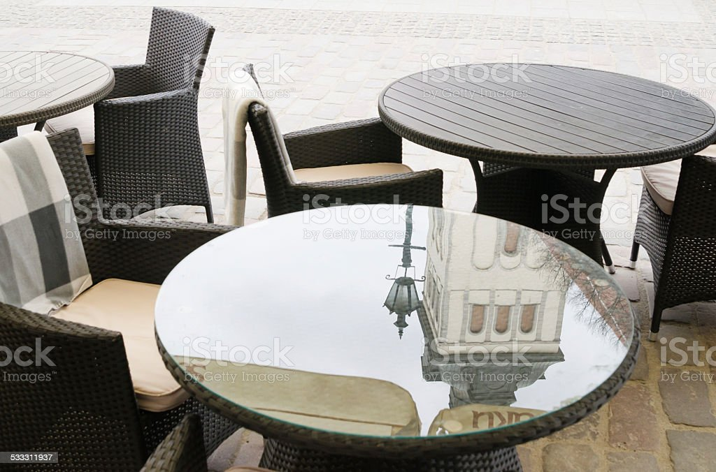 Reflection of the church spire on surface of a table stock photo