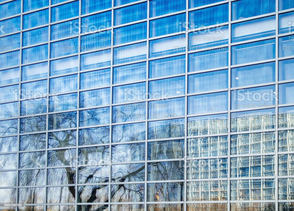 Reflection of the European Parliament building in the windows of the Council of Europe stock photo