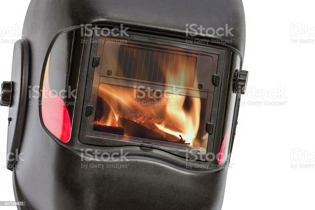 Reflection of the flame in the glass protective mask stock photo