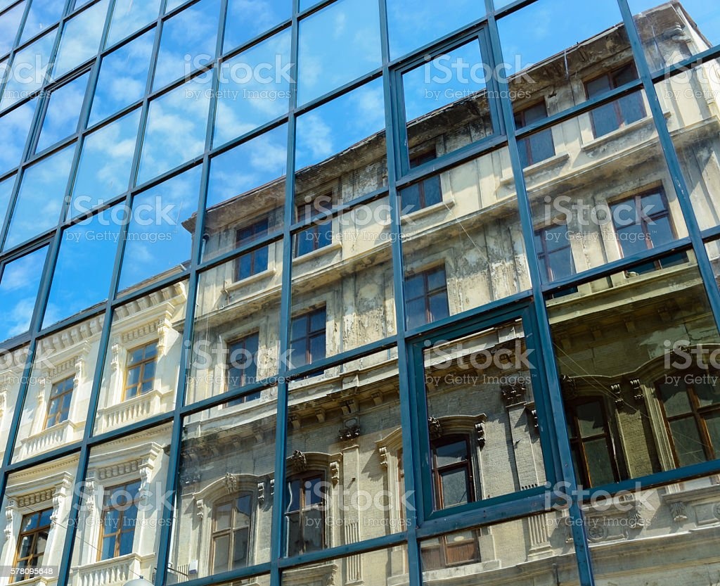 reflection of the old house and the sky with clouds stock photo