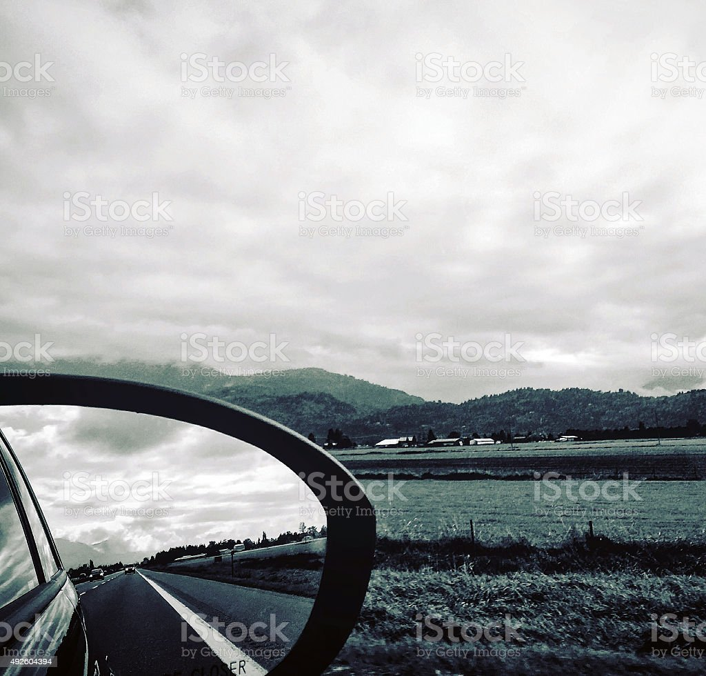 Reflection of the road on car mirror royalty-free stock photo