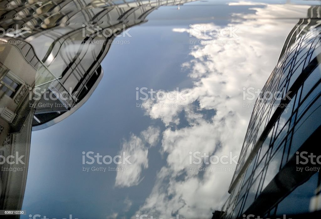 Reflection of the sky and buildings stock photo