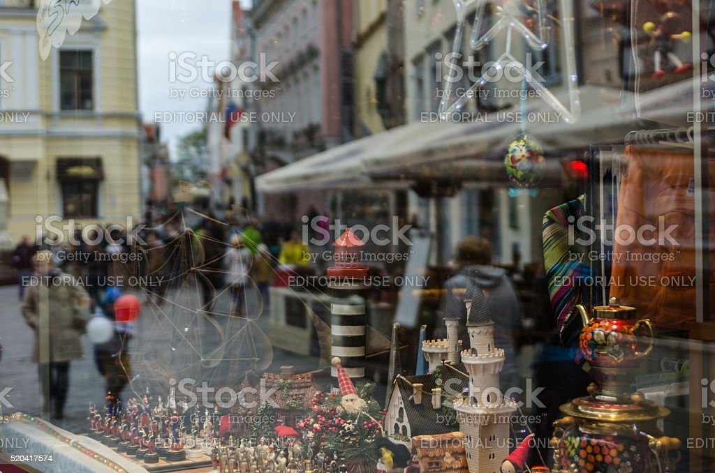 Reflection of the street with people in gift shop window stock photo