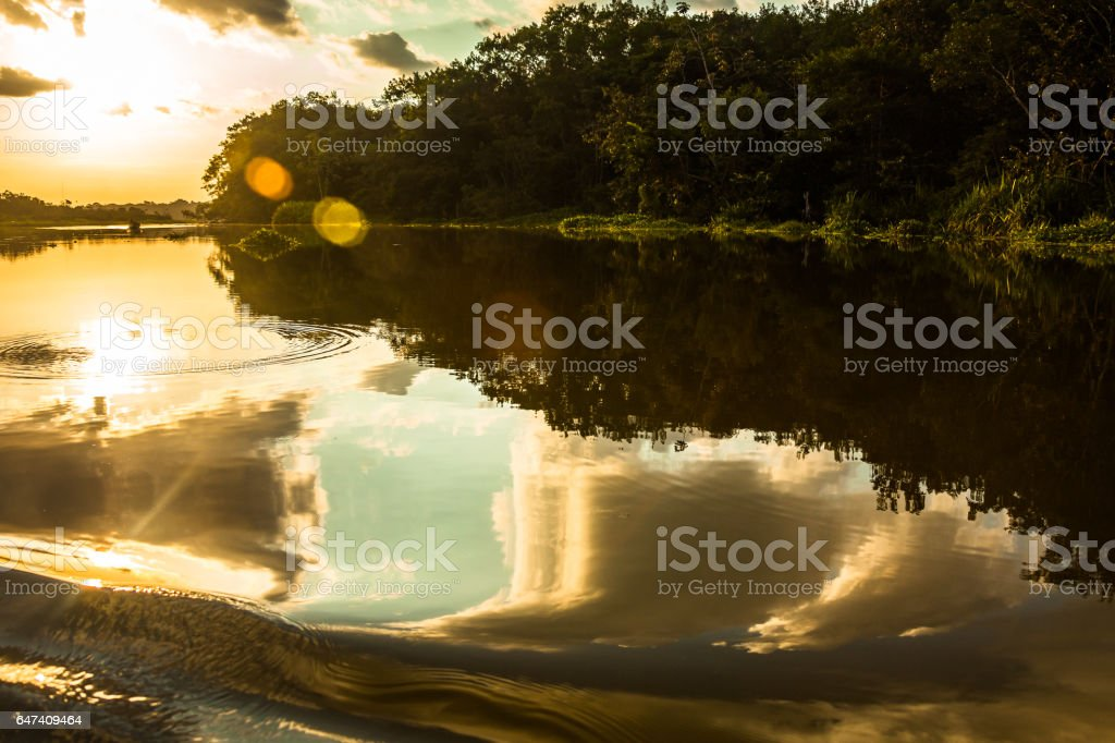 Reflection of the sun in the water stock photo