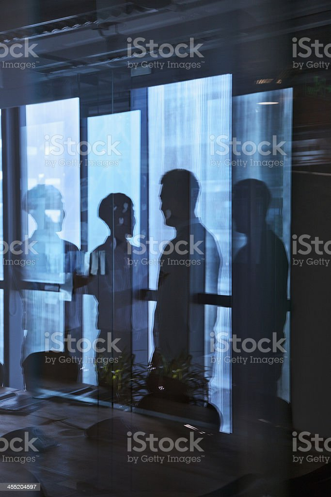 Reflection of two businessmen talking in the office royalty-free stock photo