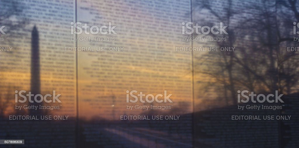 Reflection of Washington Monument in Vietnam Memorial Wall stock photo