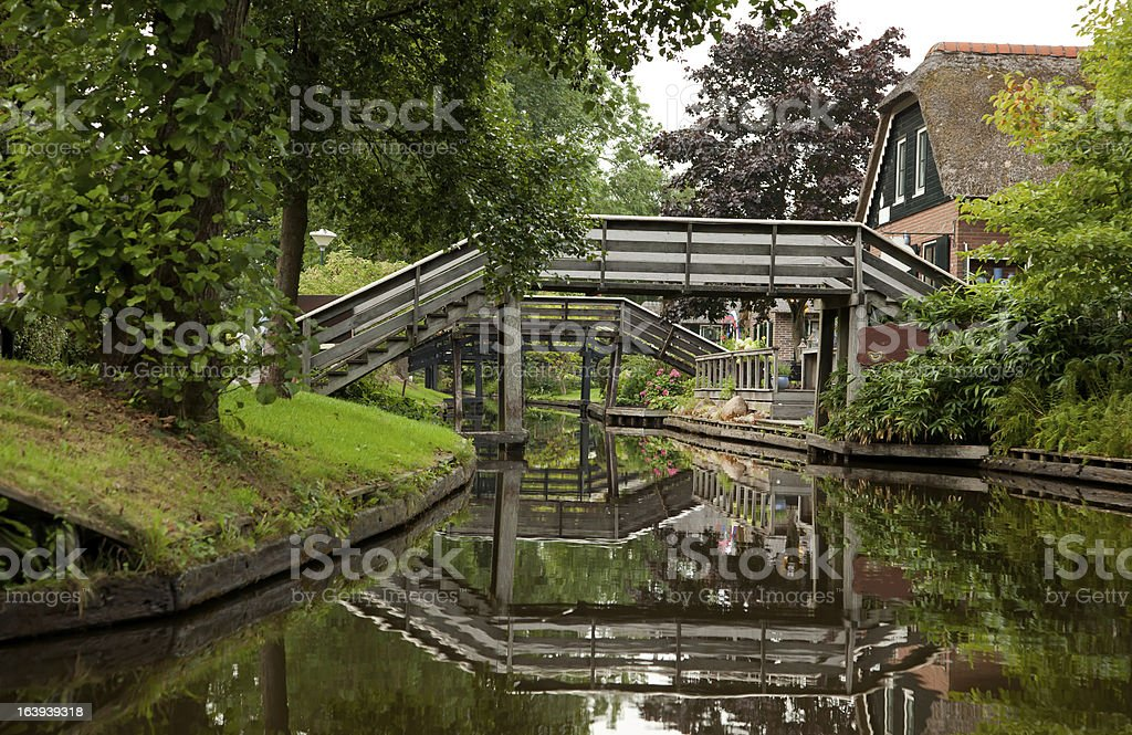 Reflection of Wooden Bridges on Canals in Giethoorn royalty-free stock photo