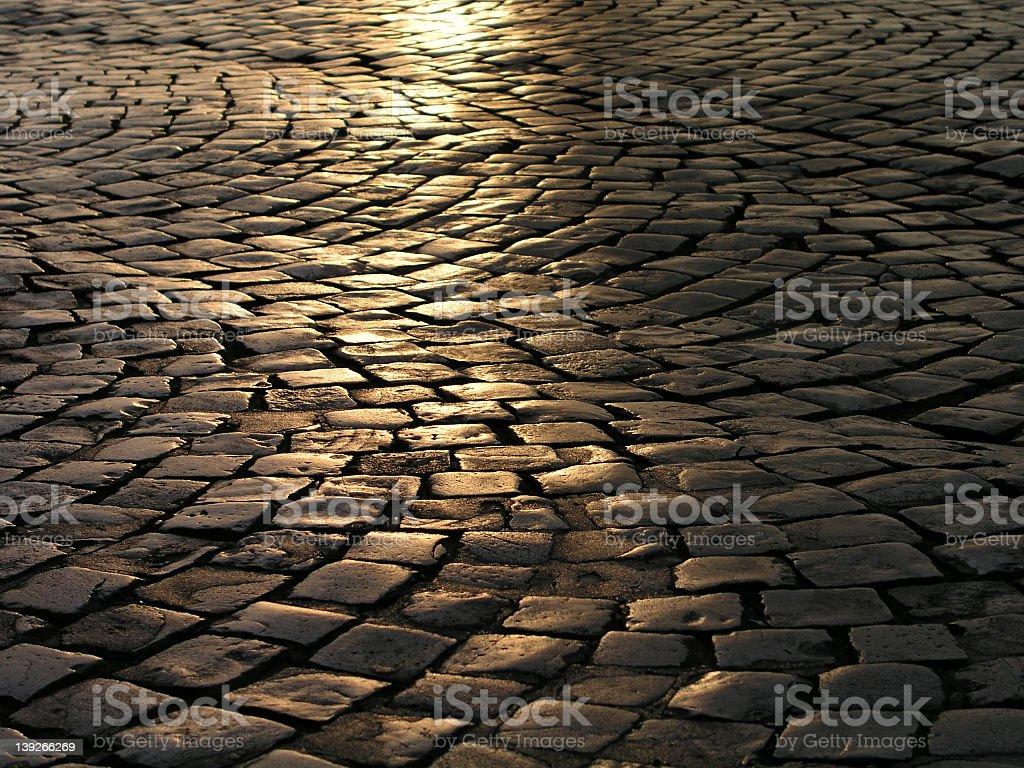 Reflection on cobblestone street royalty-free stock photo