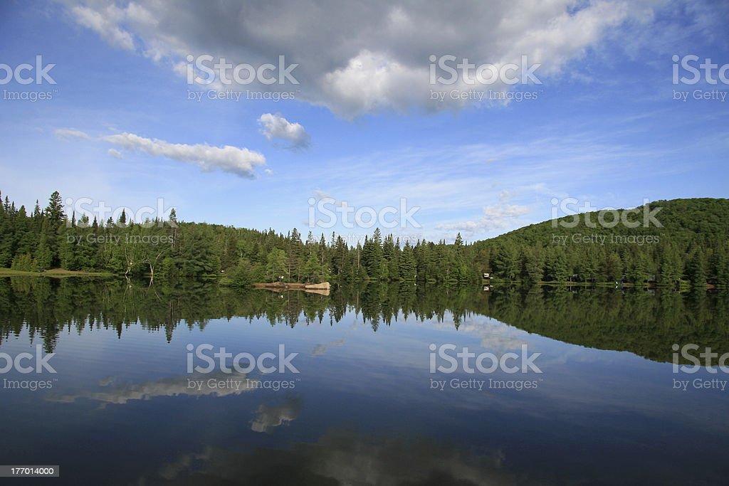 Reflection on the lake, Laurentides, Quebec stock photo