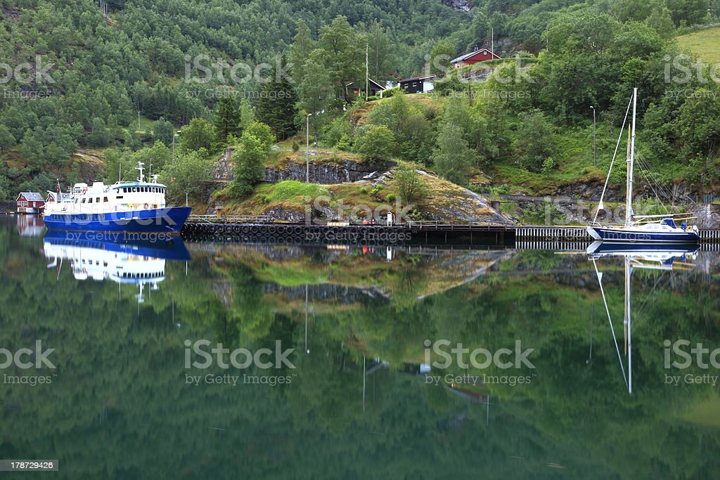 Reflection ship on fjord in Rural Norway, Nordic Countries stock photo