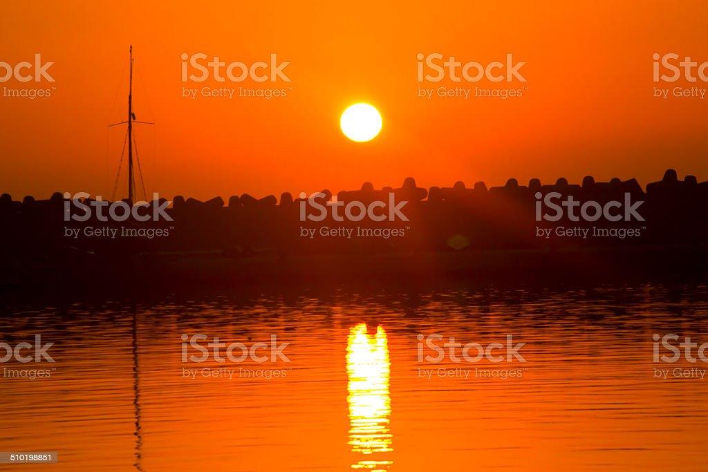 Reflection sunrise in the sea stock photo