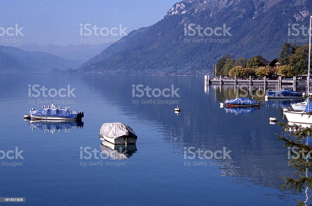 Reflection water boats at anchor Lake Brienz Interlaken District Switzerland stock photo