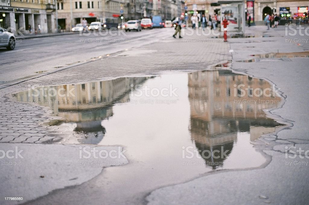 Reflections in a puddle, Budapest stock photo
