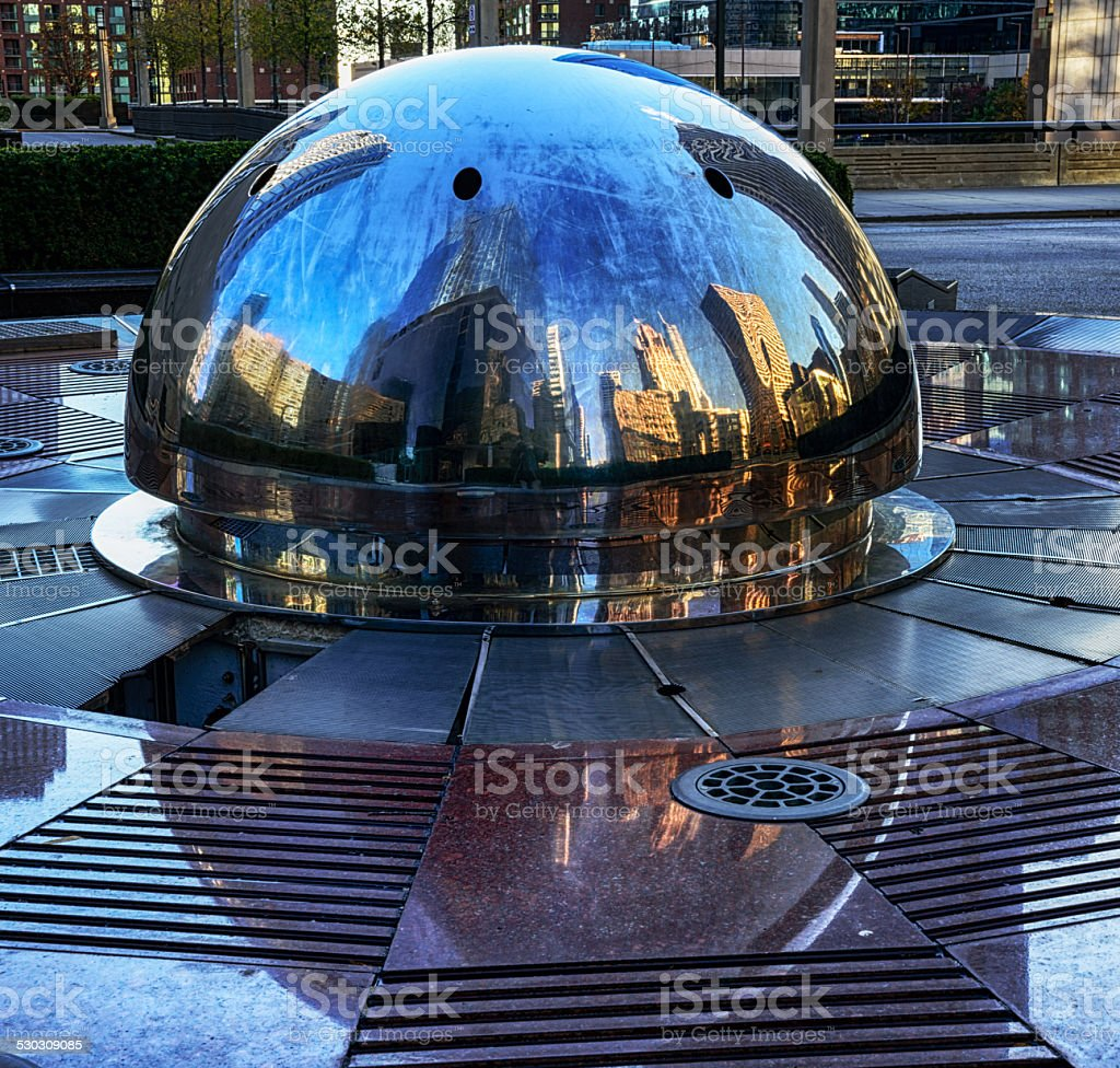 Reflections in a ventillation cover, downtown Chicago stock photo