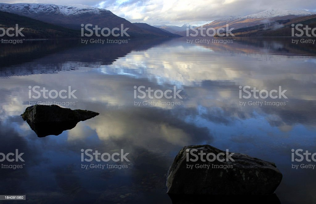 Reflections in Loch Arkaig, Scotland stock photo