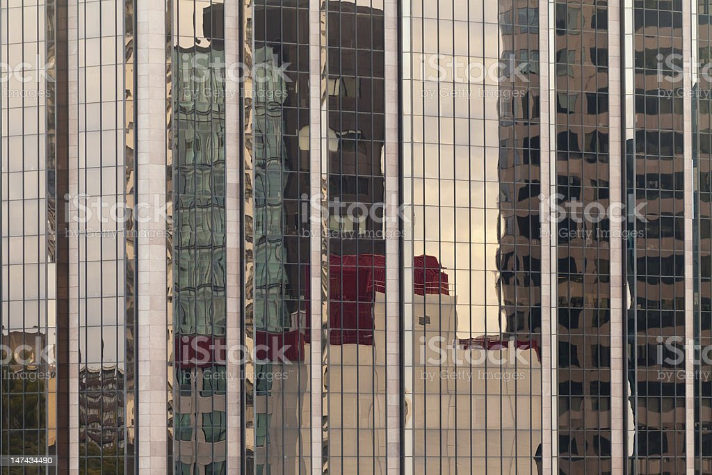 Reflections in modern glass-walled building facade stock photo