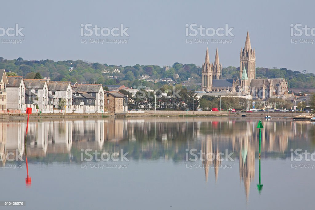Reflections in the Truro river with marker posts for shipping stock photo