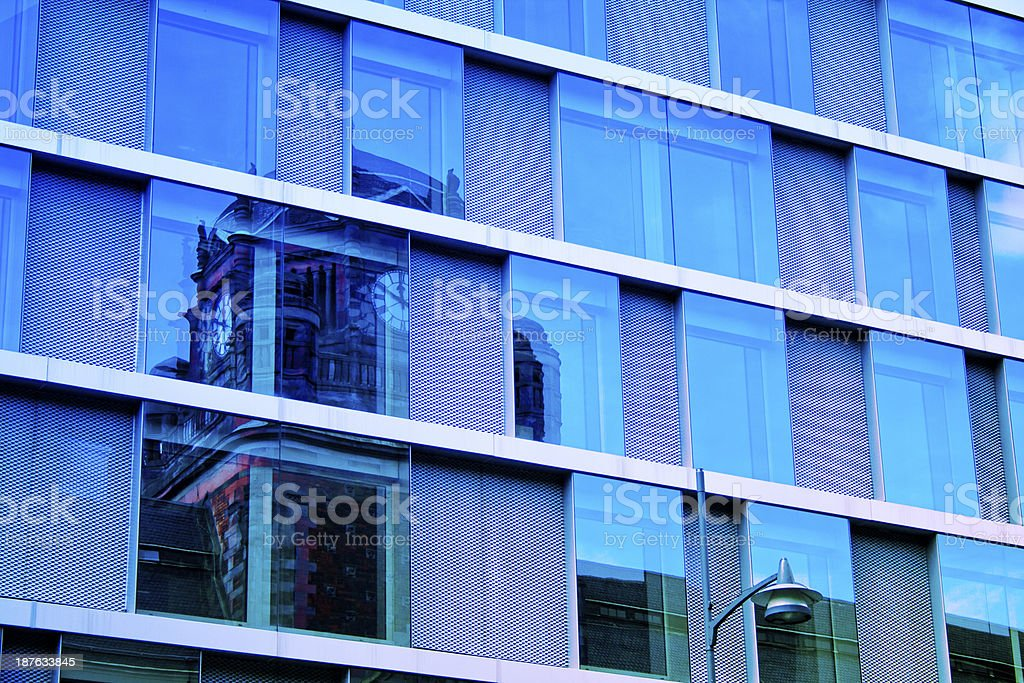 reflections in windows of office building royalty-free stock photo