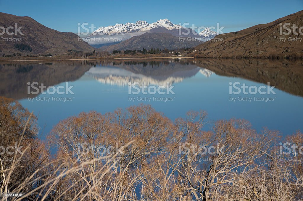 Reflections Lake Hayes stock photo