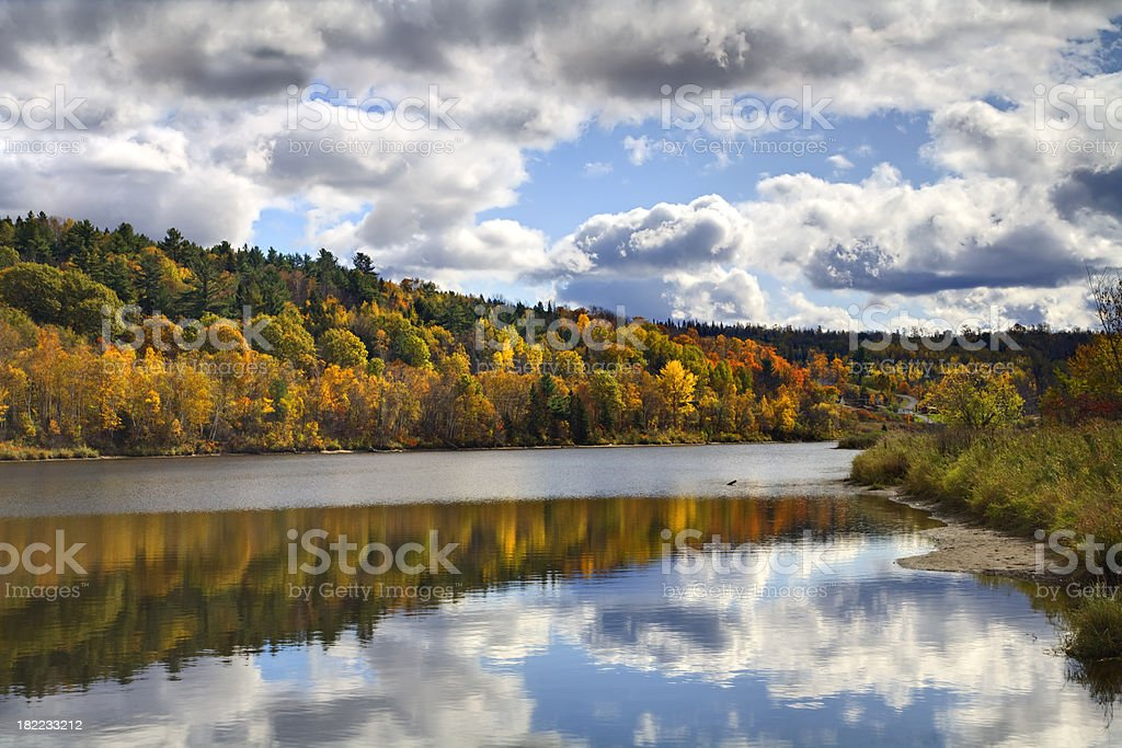 Reflections of Fall Leaves on the St. John River stock photo