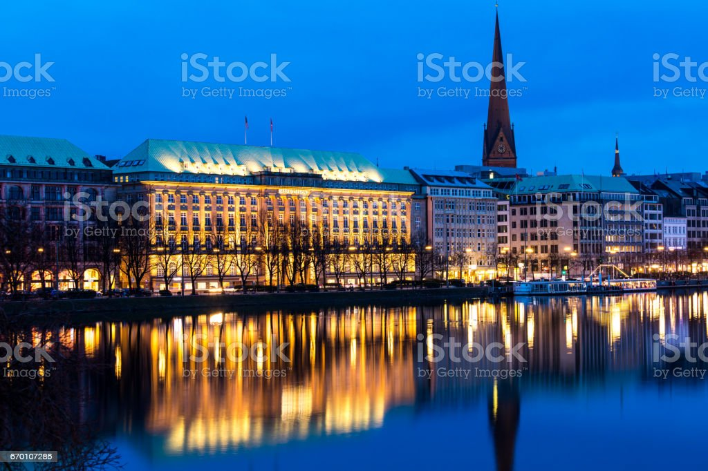 Reflections of houses in Lake Alster, Hamburg stock photo