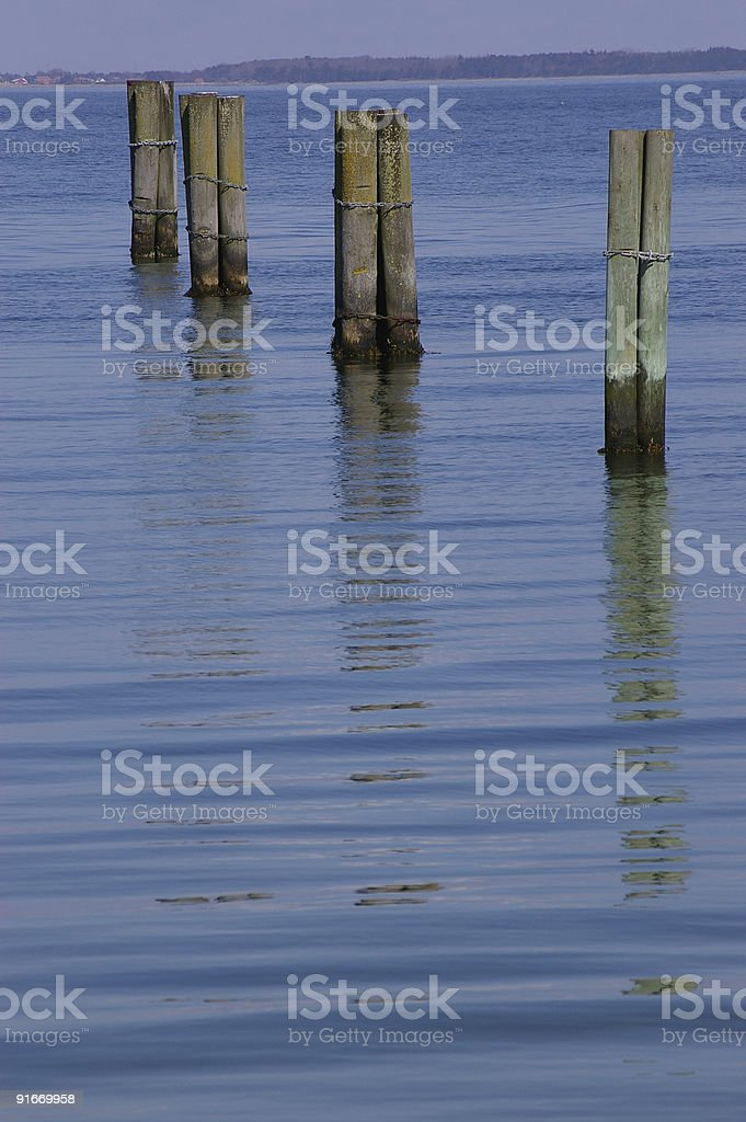 Reflections of Mooring Piles stock photo
