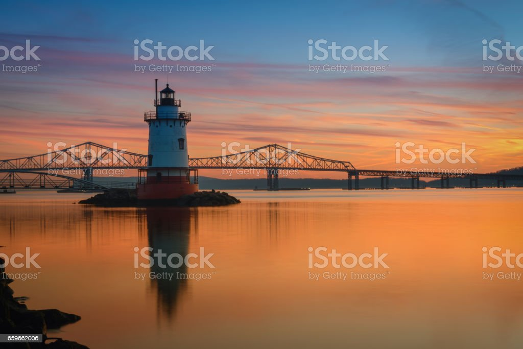 Reflections of Sleepy Hollow Lighthouse at sunset stock photo