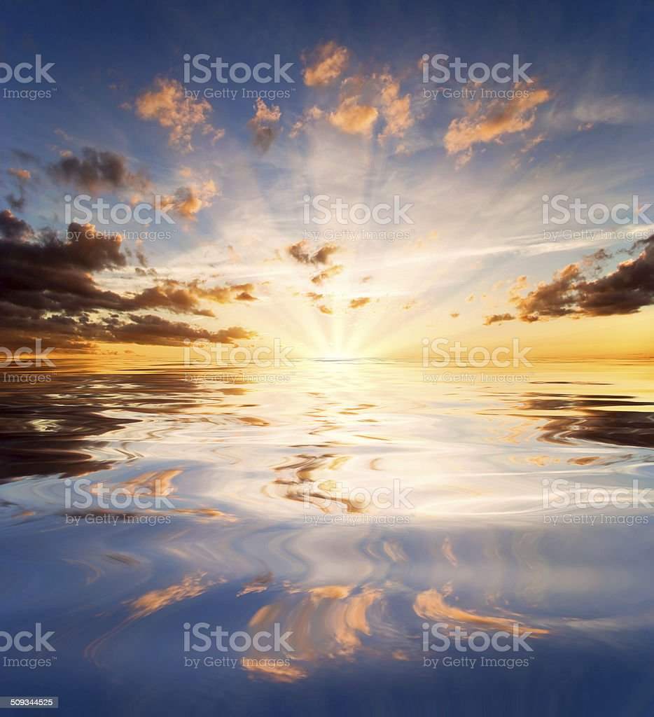 Reflections of sunset in lake water stock photo