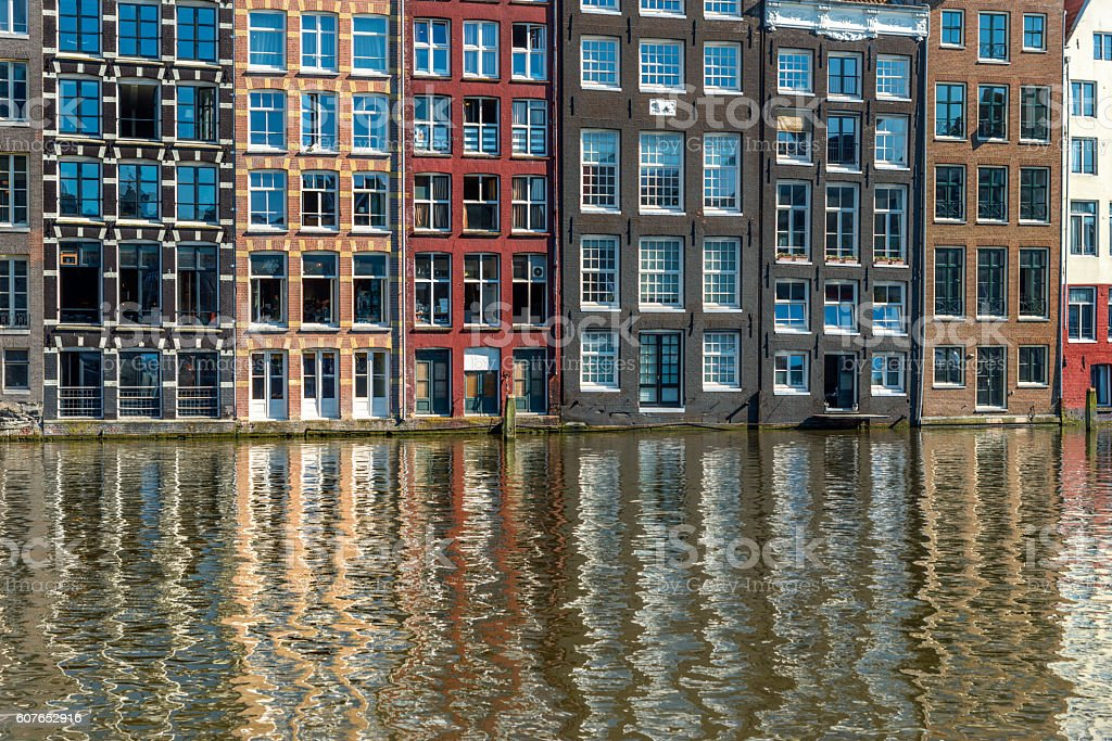 Reflections of Typical Dutch Houses in the Center of Amsterdam stock photo