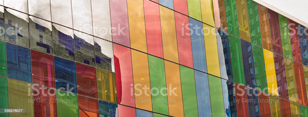 Reflections on colored stained glass building stock photo