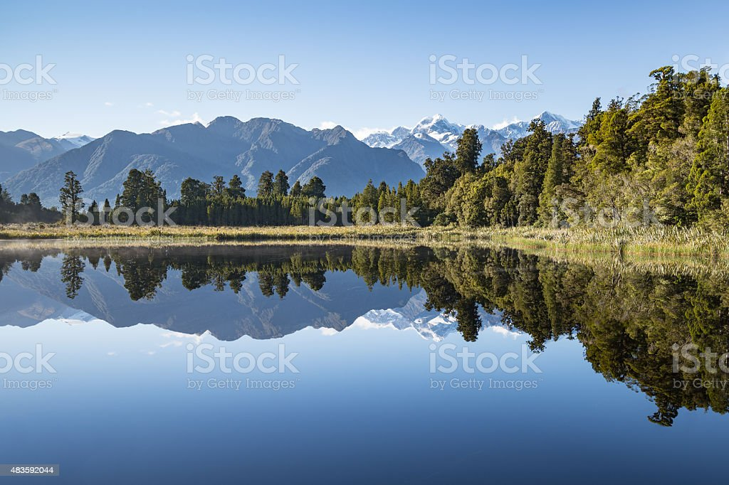 Reflections on Lake Matheson, South Island New Zealand stock photo