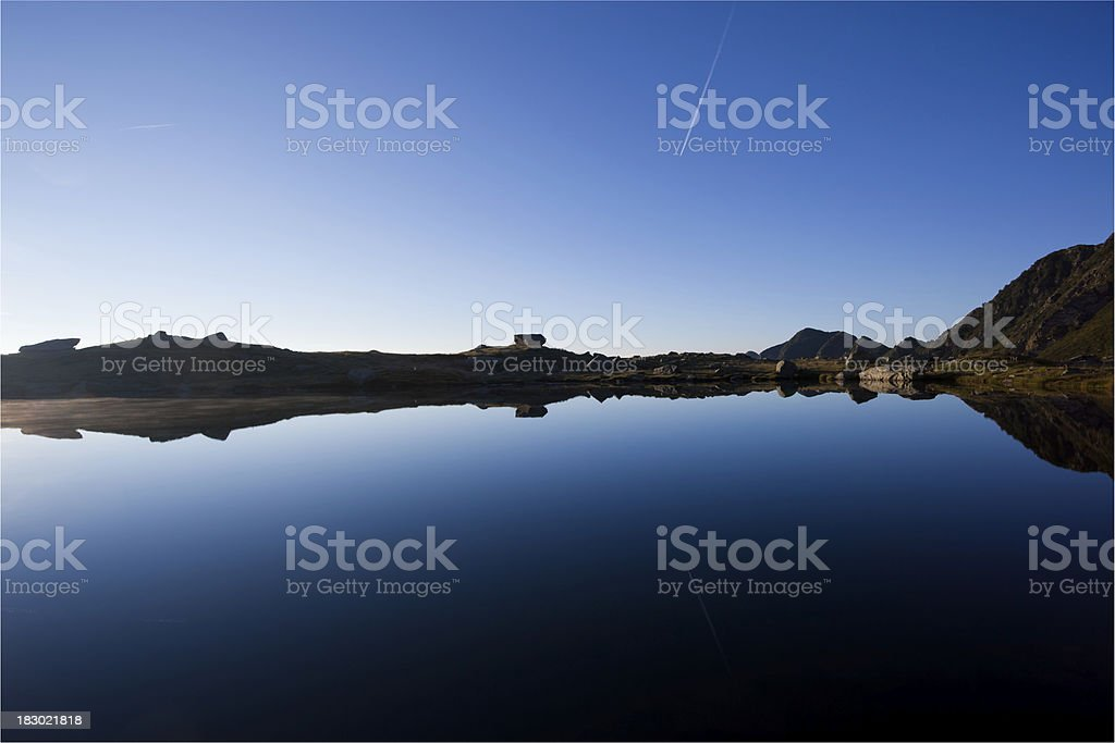 Reflections on Mountain Glacial Lake at Dawn,Dolomites, Italy royalty-free stock photo