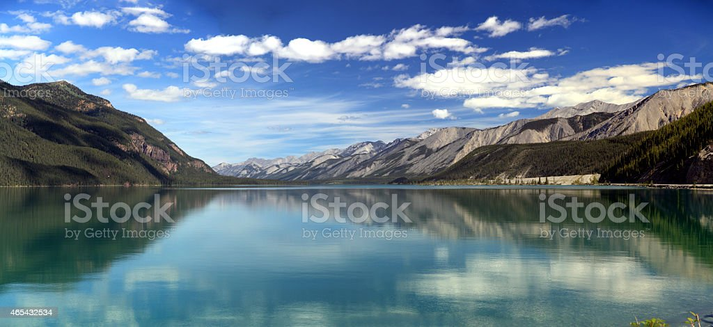 Reflections on Muncho Lake in northern British Columbia, Canada. stock photo