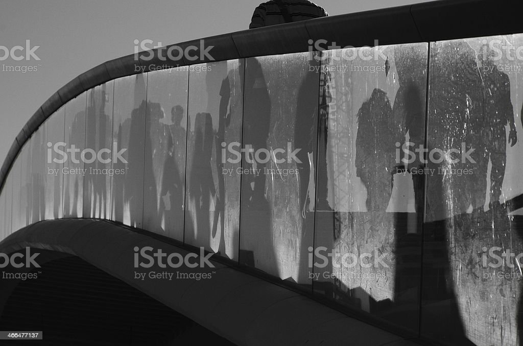 Reflections on the glass balustrade of a bridge stock photo