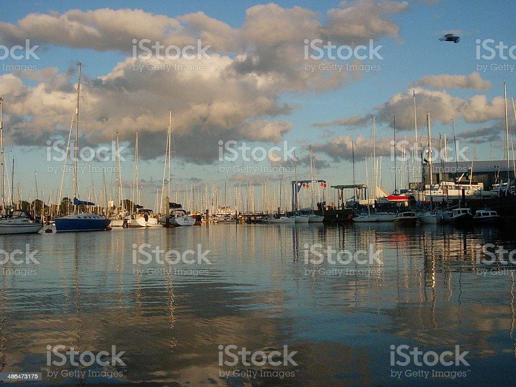 Reflections on the sea at Lymington stock photo