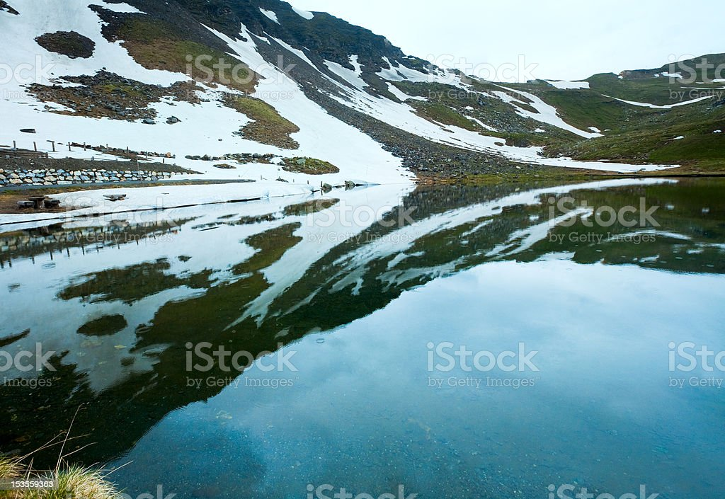 Reflections on the summer alpine lake royalty-free stock photo