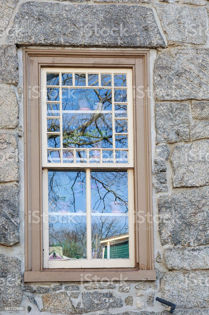 Reflections on the Window of an Old Stone House, Verticle stock photo