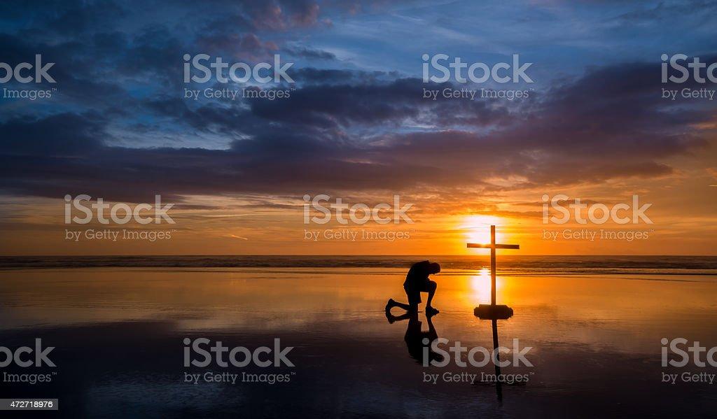 Reflecton Praying Man Cross stock photo